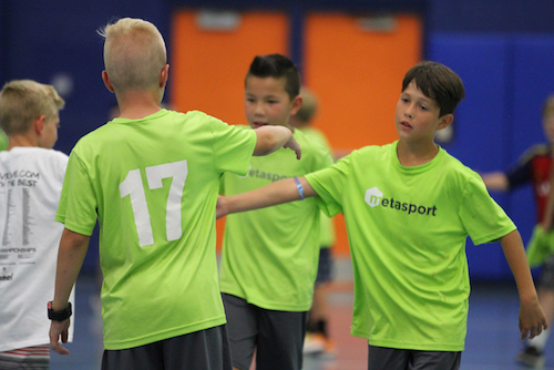 Players shake hands during multisport training at MetaSport soccer club.