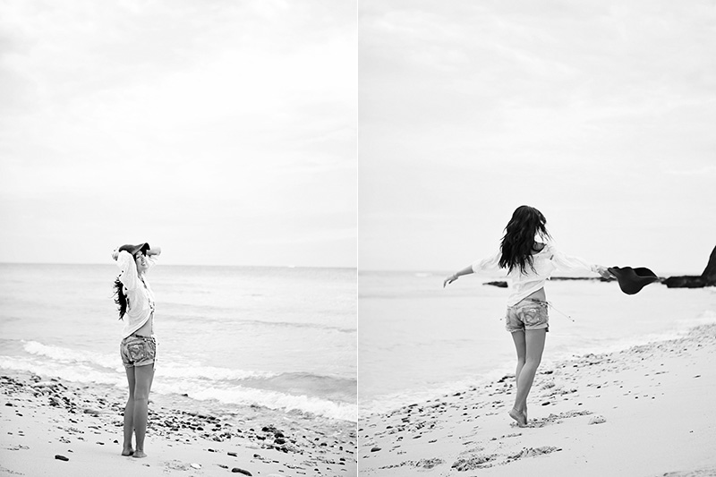 Woman twirling on a beach