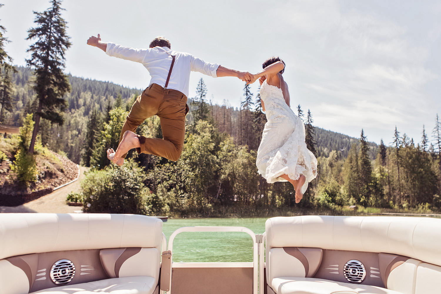 Bride and Groom jump off a boat