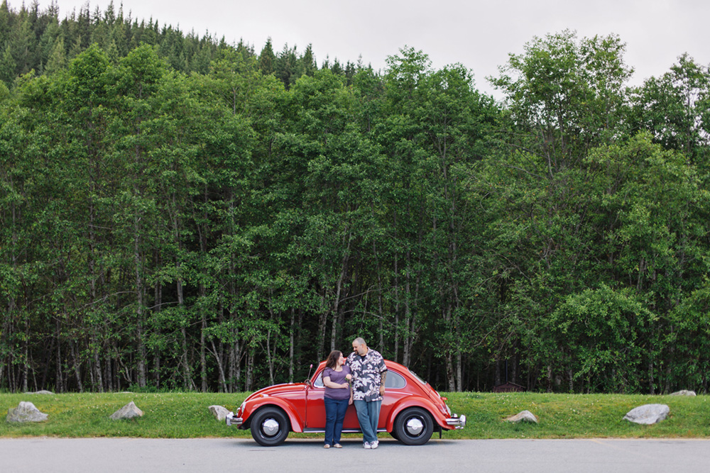 couple in front of red VW bug  by Vancouver photographer