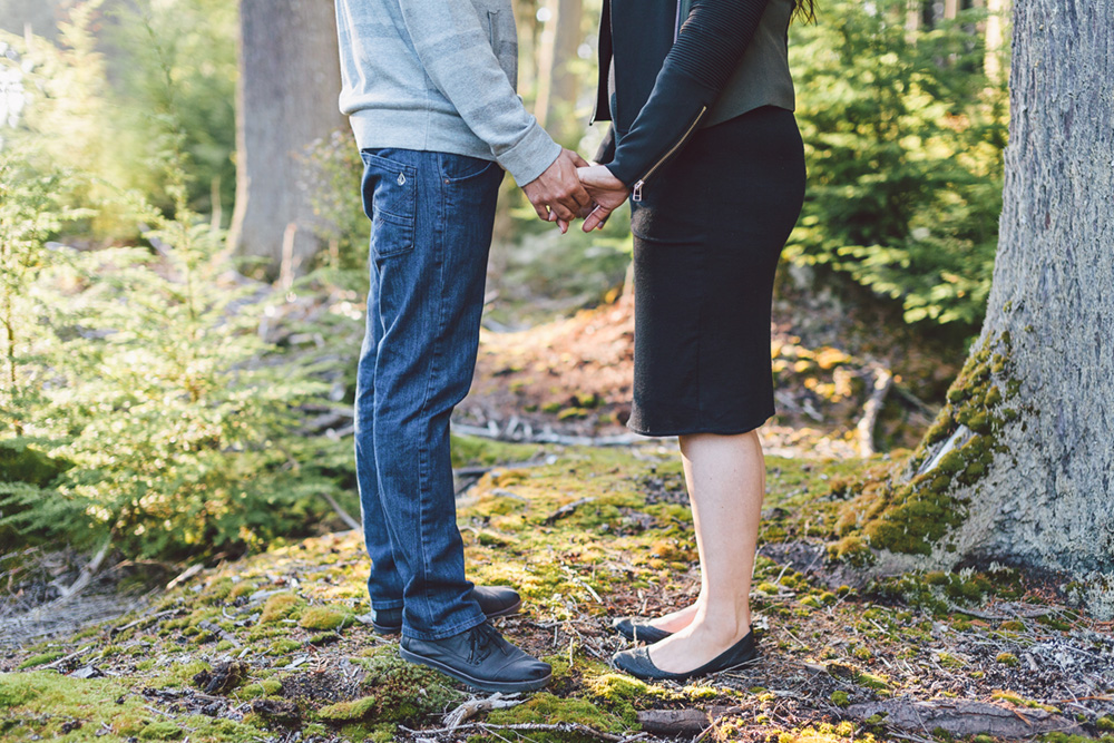 couples legs while holding hands  by Vancouver photographer