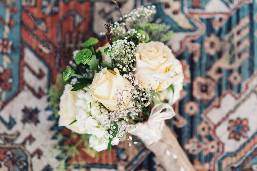 Vancouver wedding photos: A bouquet of flowers on a colourful rug