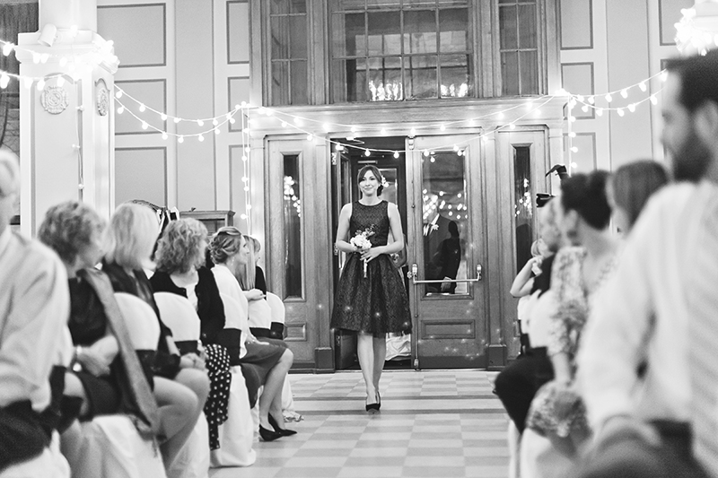 maid of honor walking down the aisle
