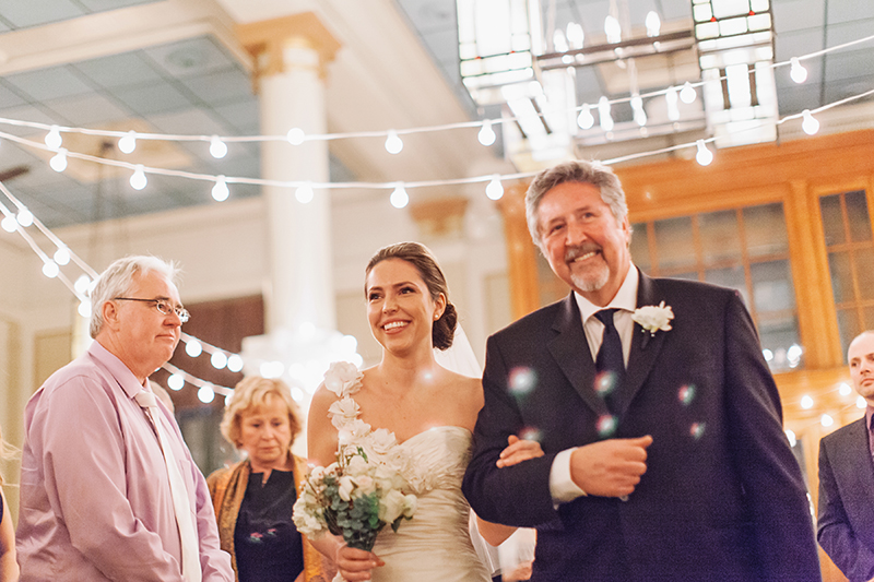 father of the bride walking bride down aisle