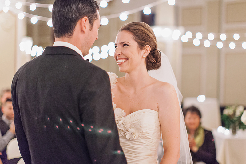 bride smiling at groom after first kiss