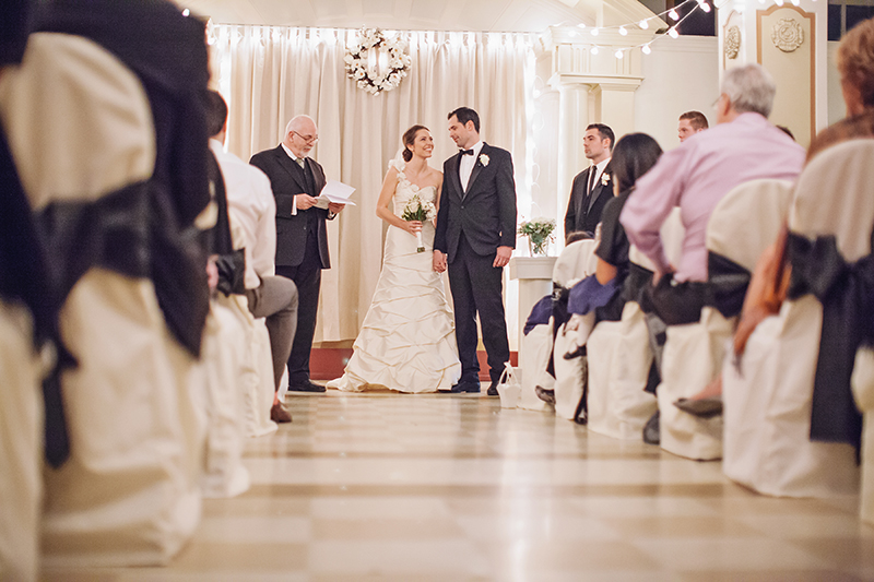 bride and groom at end of aisle during ceremony