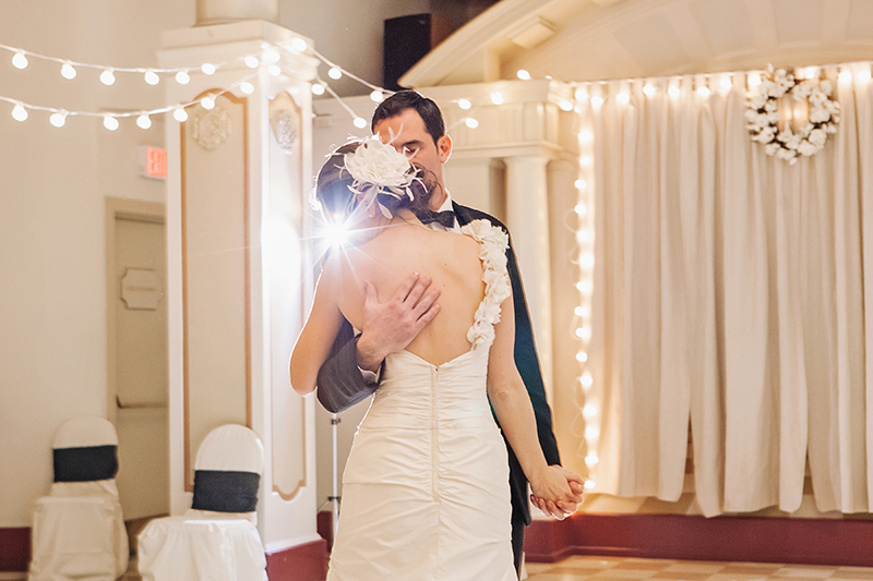 bride leaning head on groom during first dance