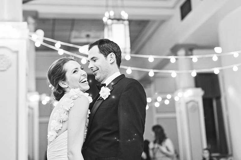 laughing bride during first dance