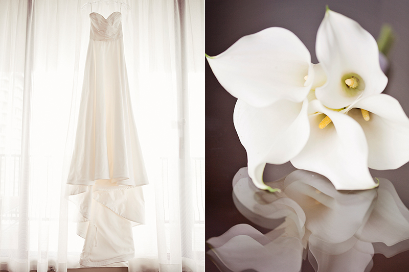 wedding dress hanging from window, reflected flowers
