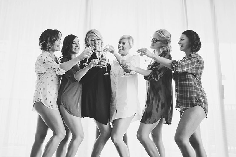 portrait of bride and bridesmaids cheersing