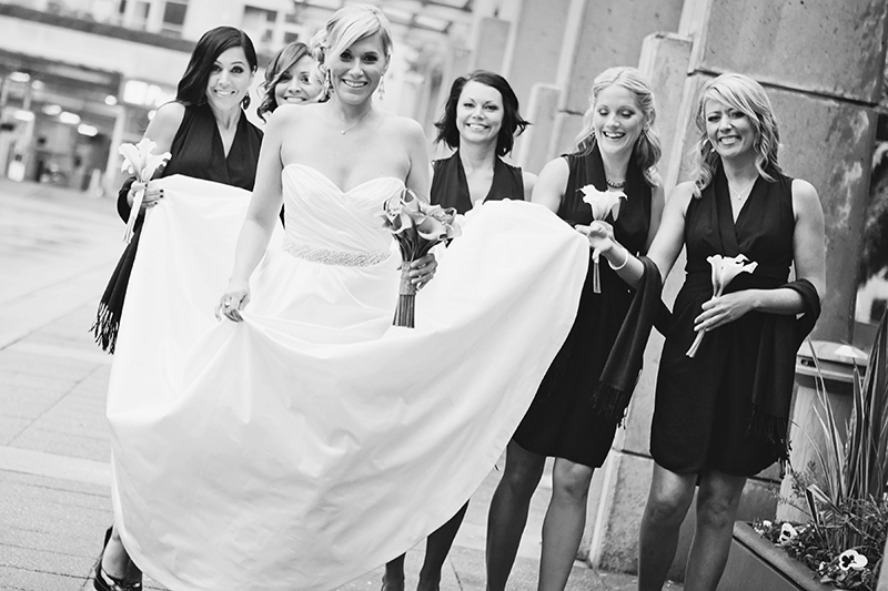 bride walking with bridesmaids down street