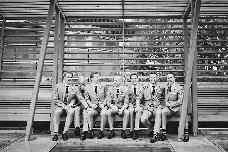 portrait of groom with groomsmen laughing