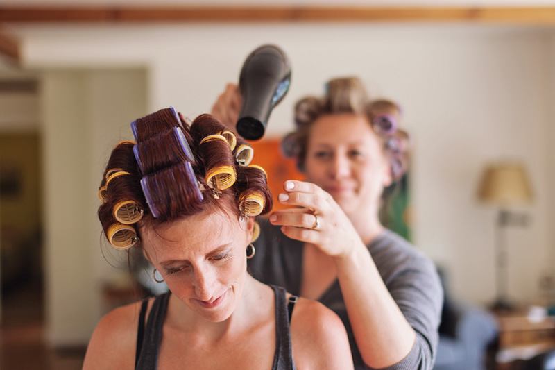 bridesmaid doing other bridesmaids hair