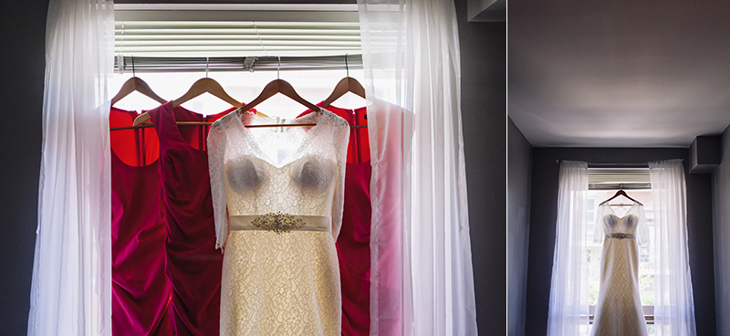 brides dress hanging in window/with bridesmaids dresses