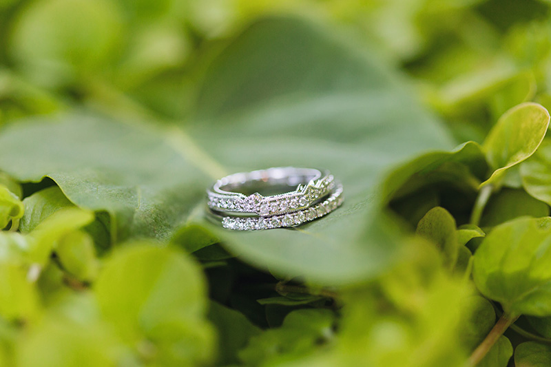 two wedding bands in a leaf