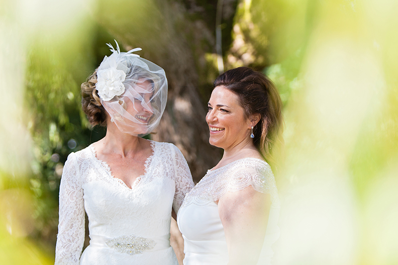 two brides smiling