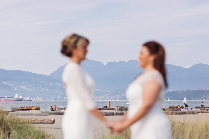 jericho beach with two brides