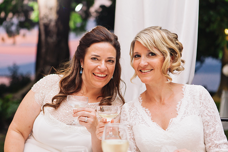 two brides smiling during reception