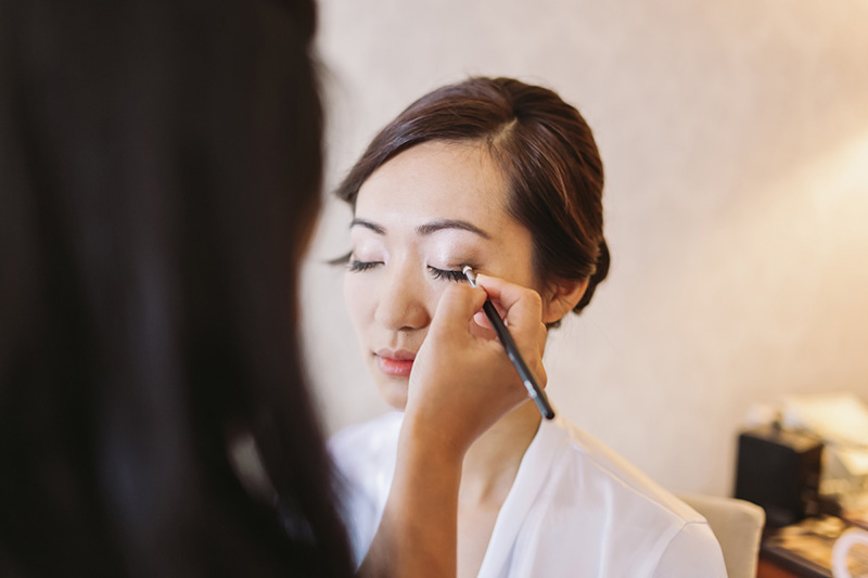 Vancouver wedding photography: bride having make up done