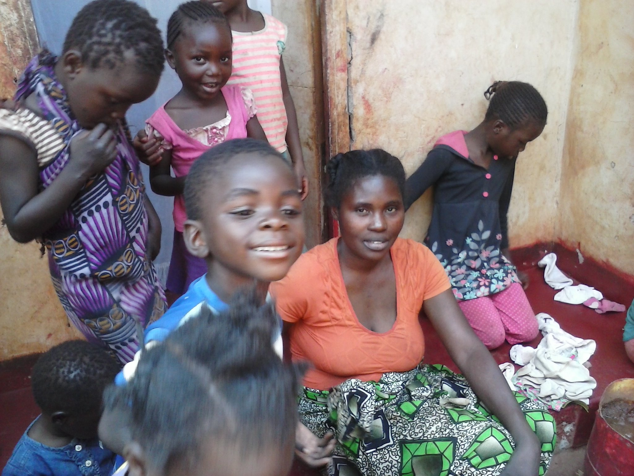 Mulenga visits a mother and her children at their home in Chainda compound during his August 2014 visit to Zambia
