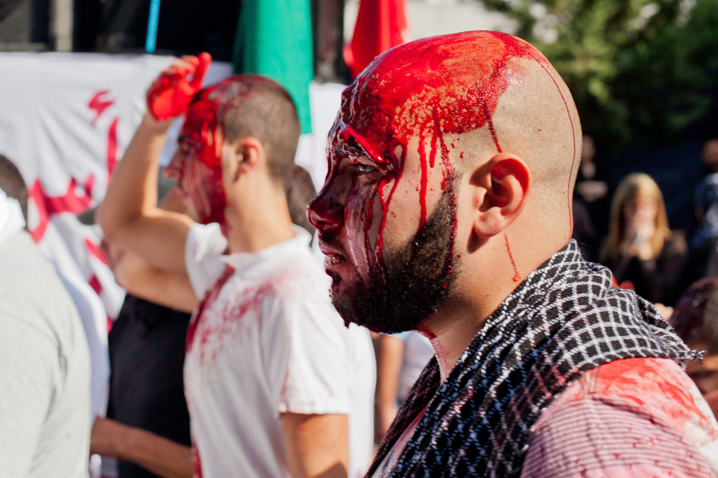 A blood-soaked man marches in this Ashura procession. (Courtesy James Haines-Young)