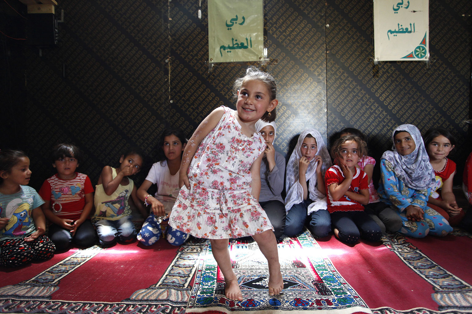 Syrian refugee children participate in a religion class. Photographed in the Ketermaya informal tented settlement (ITS), outside Beirut, Lebanon on June 1, 2014. (Courtesy Dominic Chavez/World Bank)