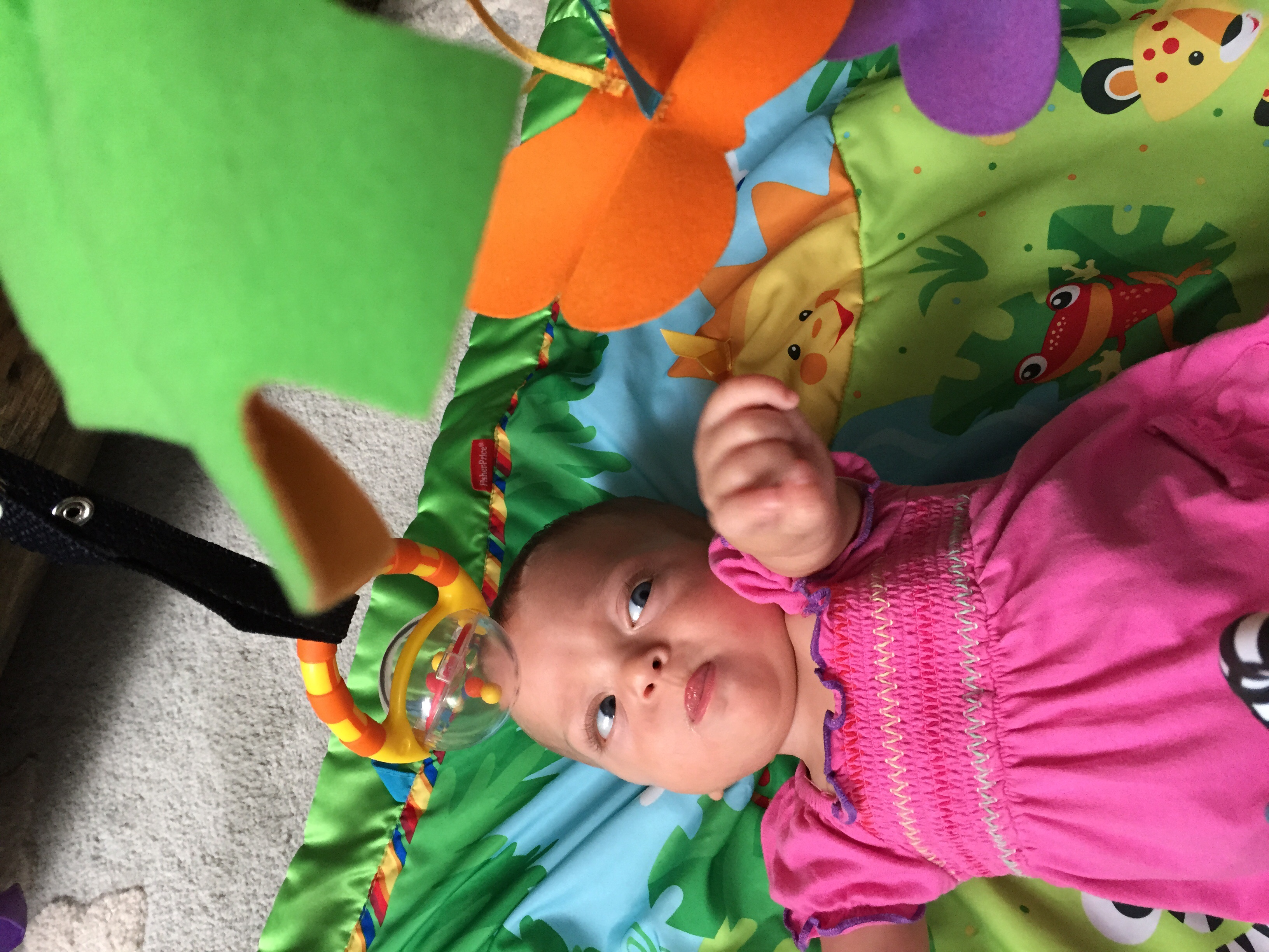 Reaching for the butterflies, sticking her tongue out in deep concentration, just like her Papa.