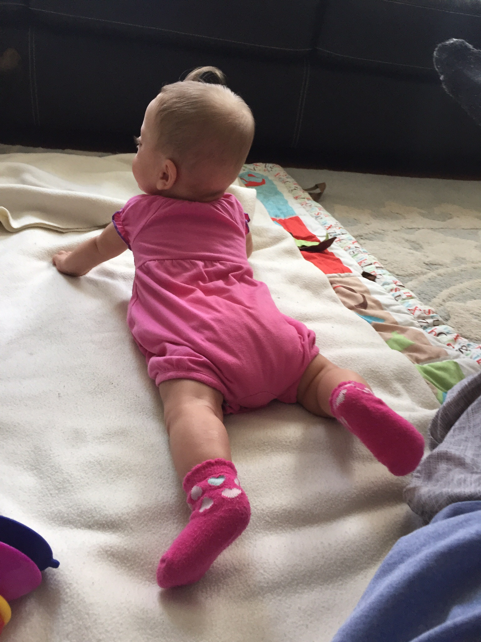 Rocking tummy time, strengthening her core!