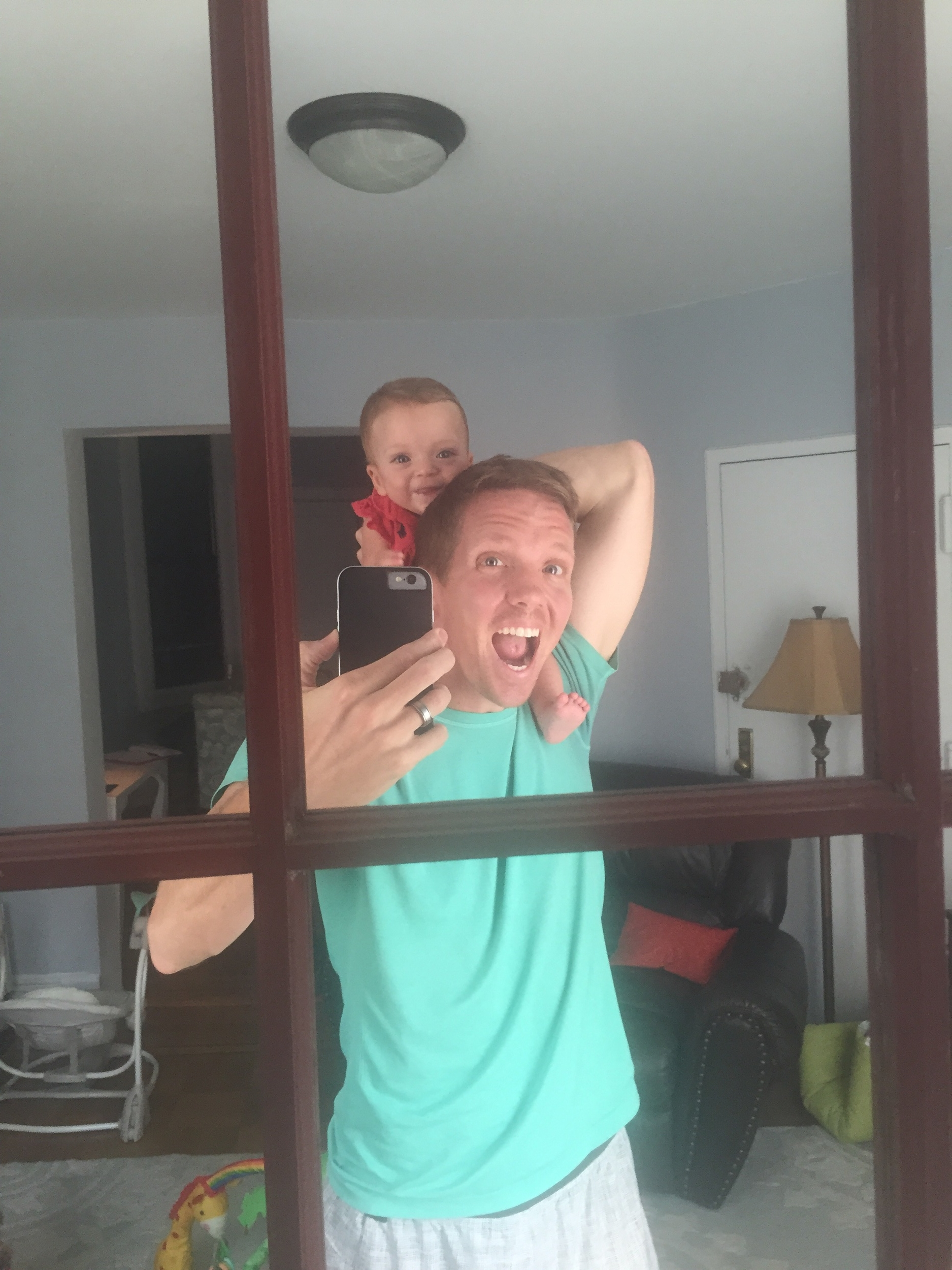 Discovering the mirror/play time with daddy