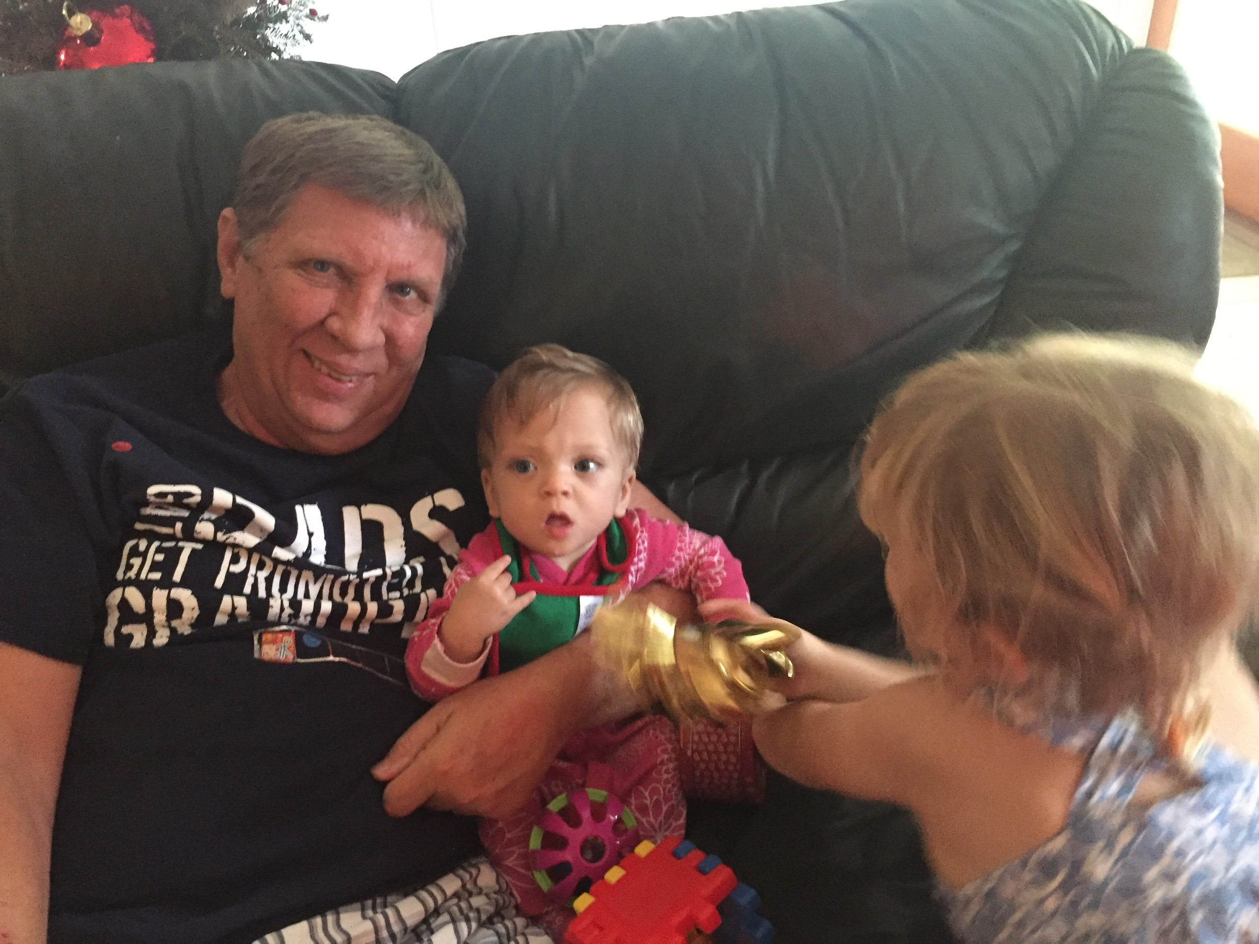 Abbo with his two granddaughters