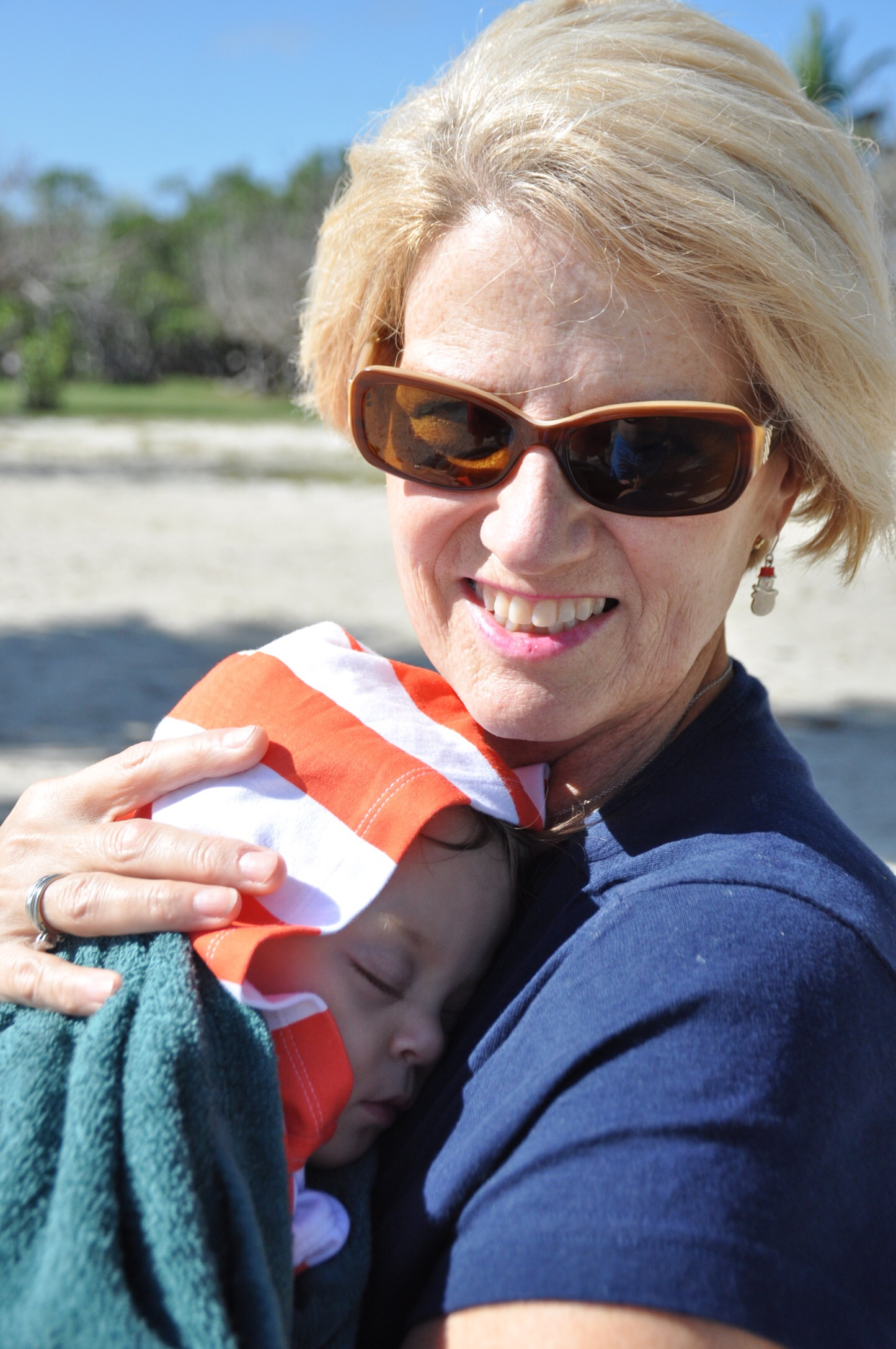 Beach naps are the best, especially with snuggles with her Great-Aunt Neise!