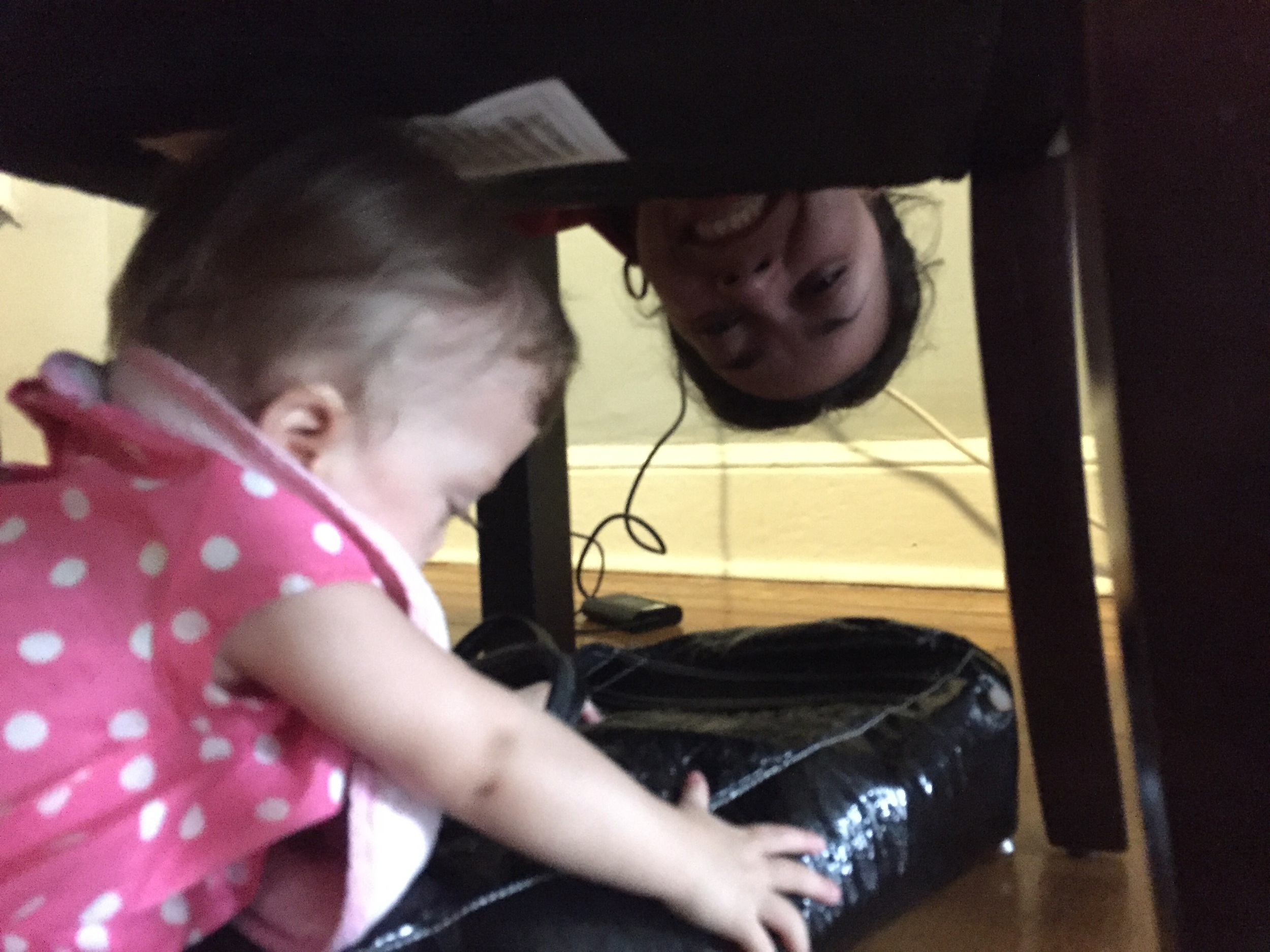 Crawled under the chair to get mommy's purse, almost made it without being caught.