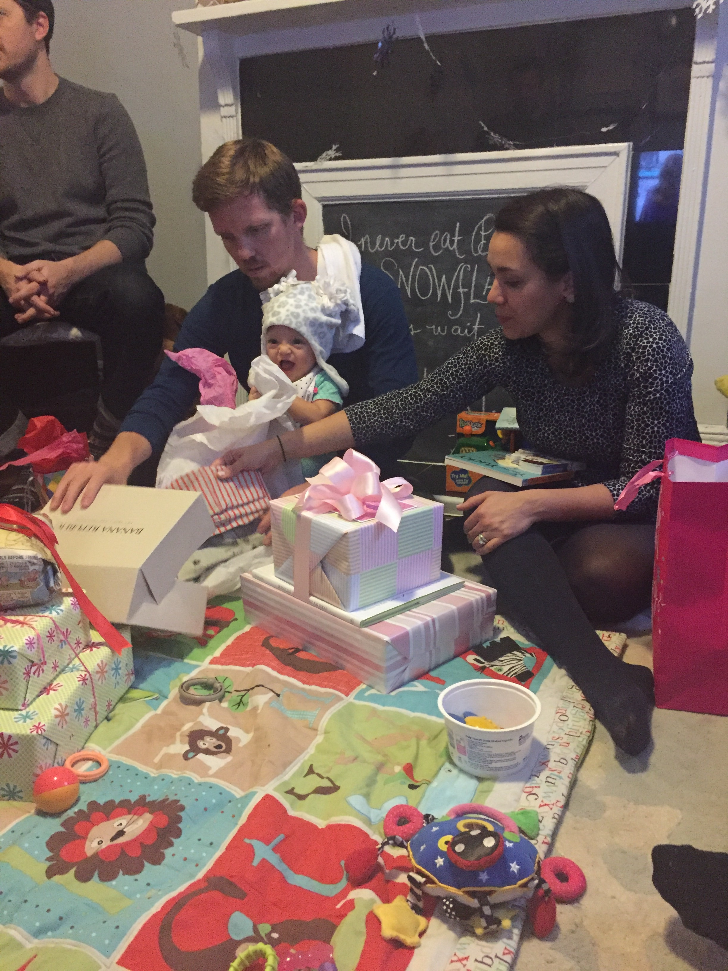 Preseeeeeents!!! Lucie learned very quickly how to help open her gifts ;).