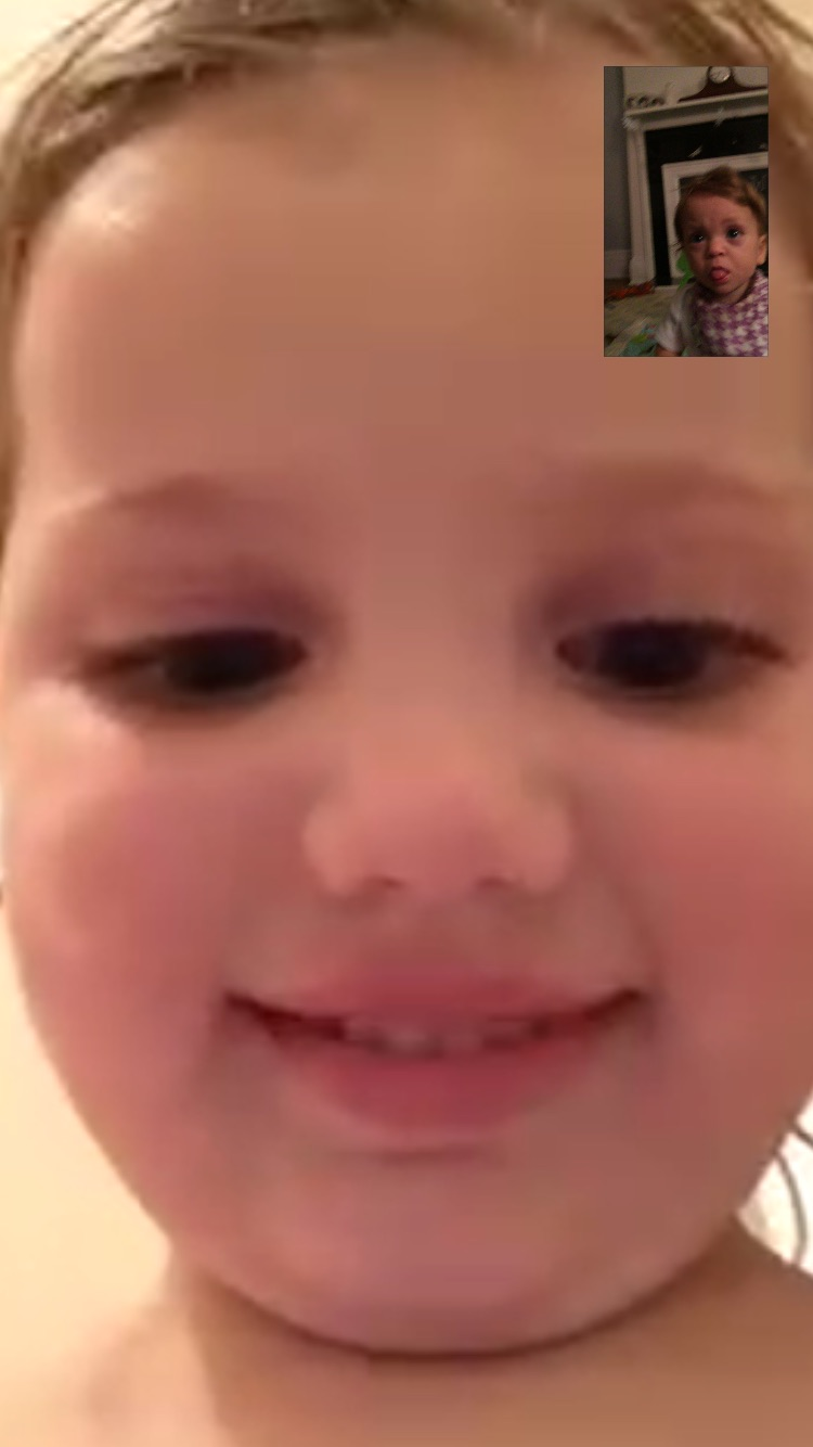 Oh, technology! FaceTimeing with her cousin, Addi.