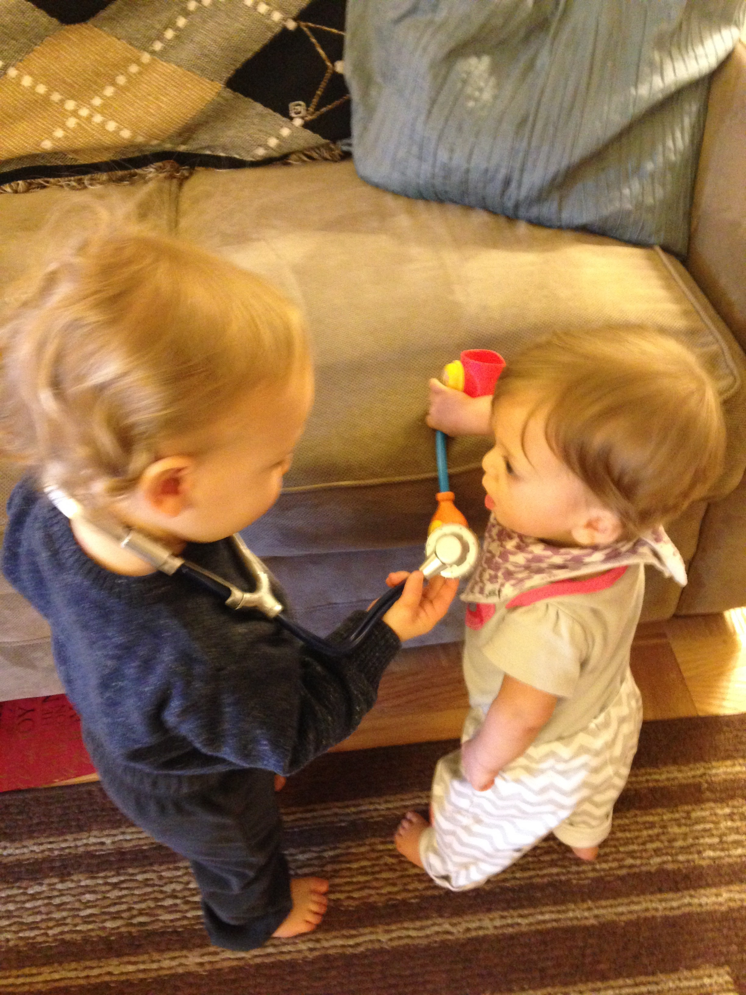Playing 'Doctor' with her friend Luke!