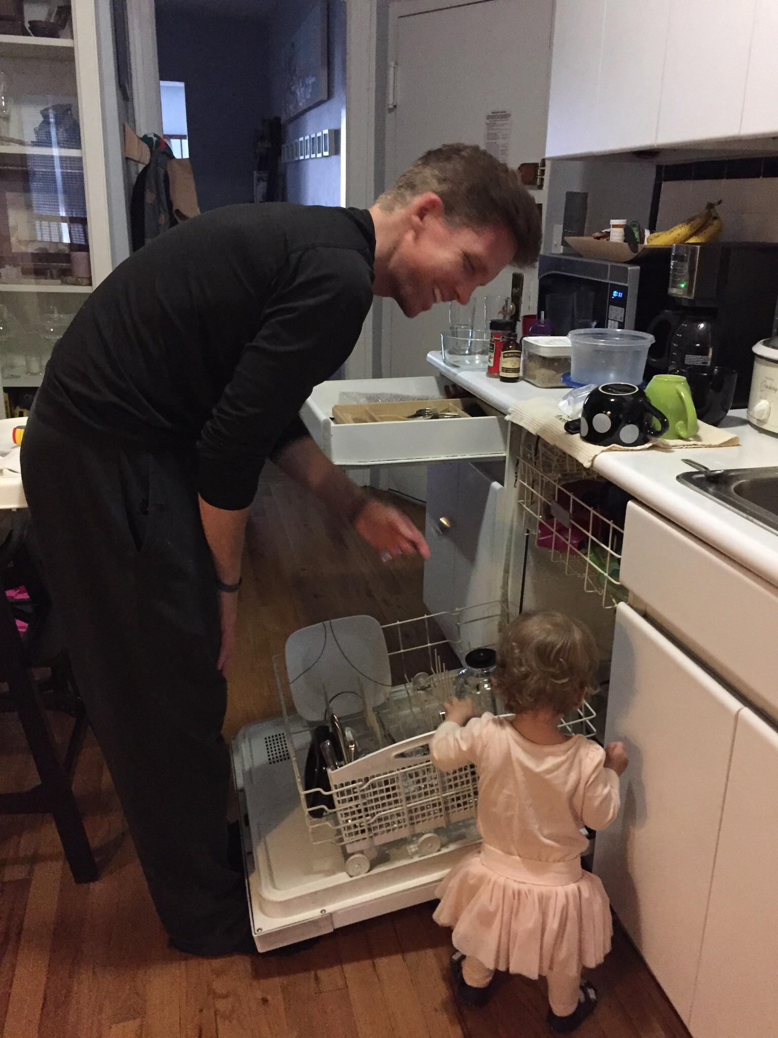 Lucie's finally pulling her weight! Helping Dada empty the dishwasher.