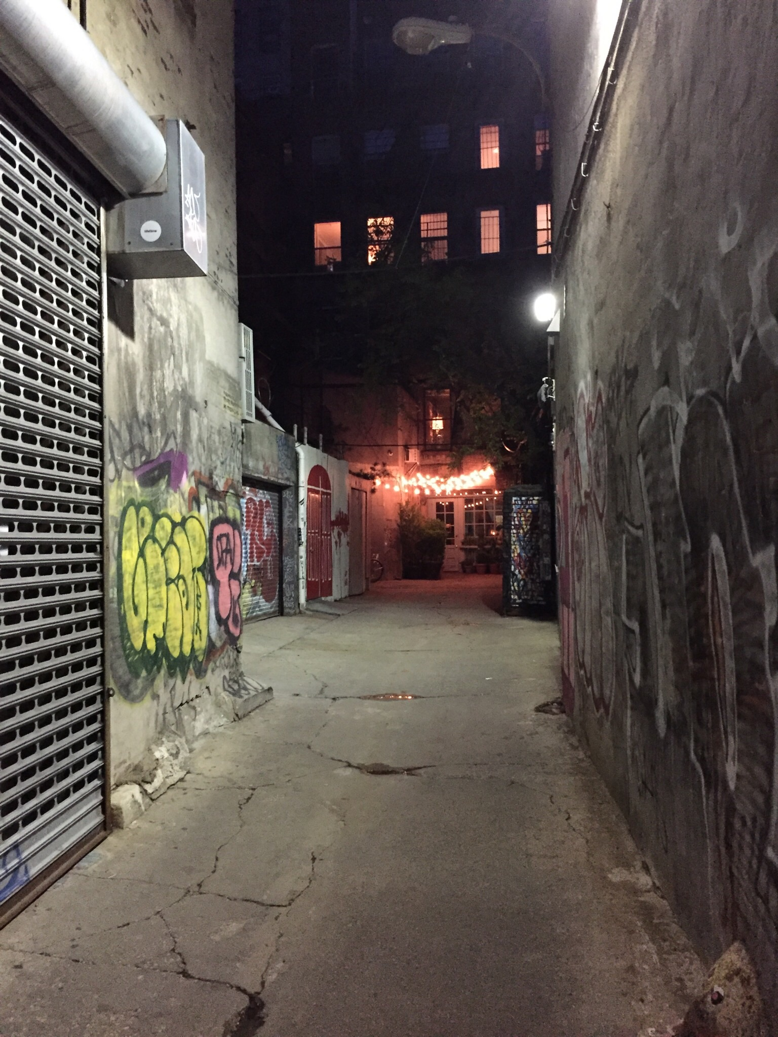See that string of lights at the end of the alley? That's the entrance to the restaurant.