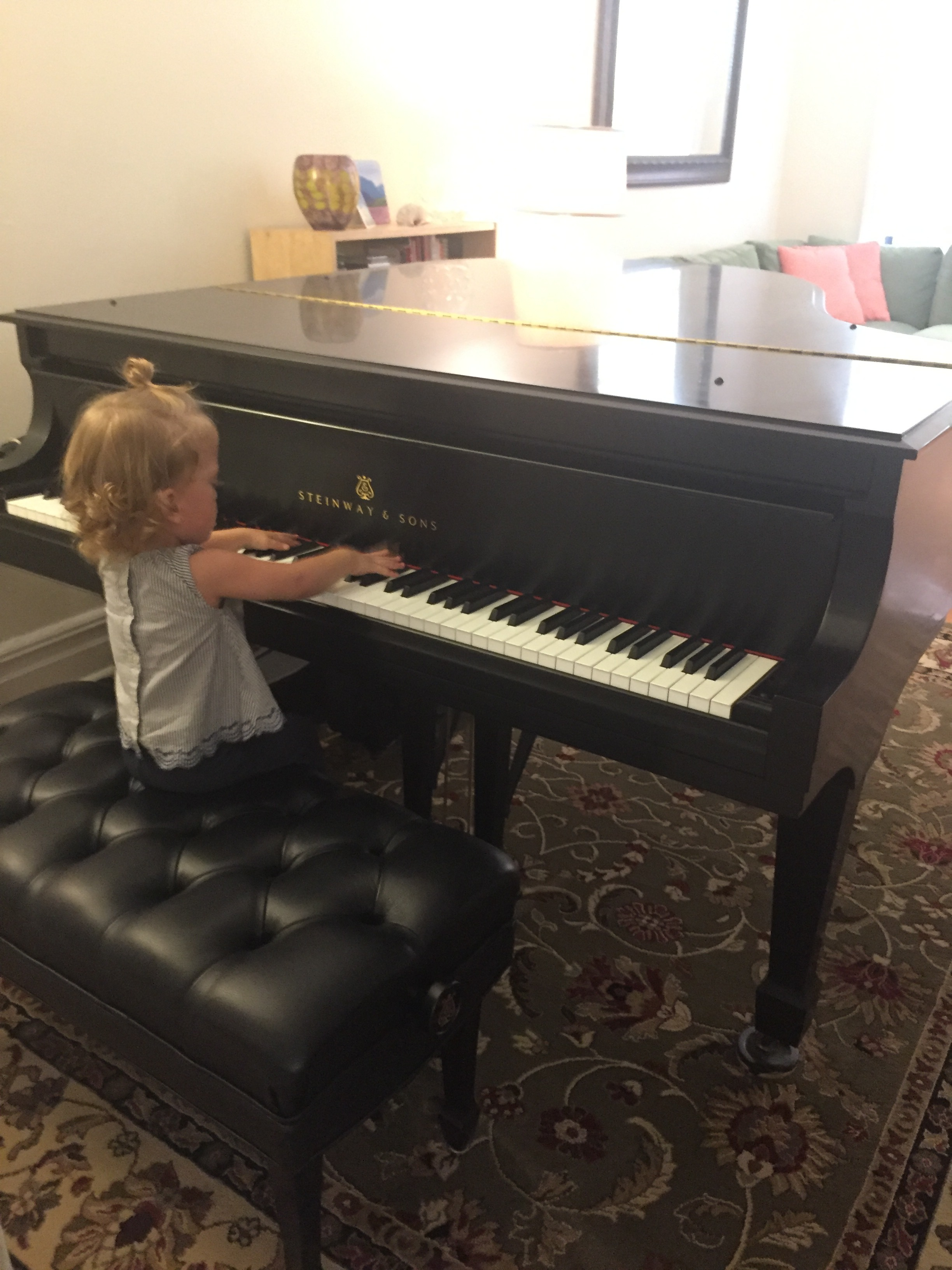 Lucie playing Sharon's piano.