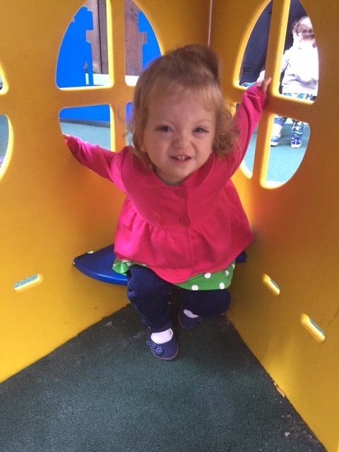 Lucie loving the playground at school.
