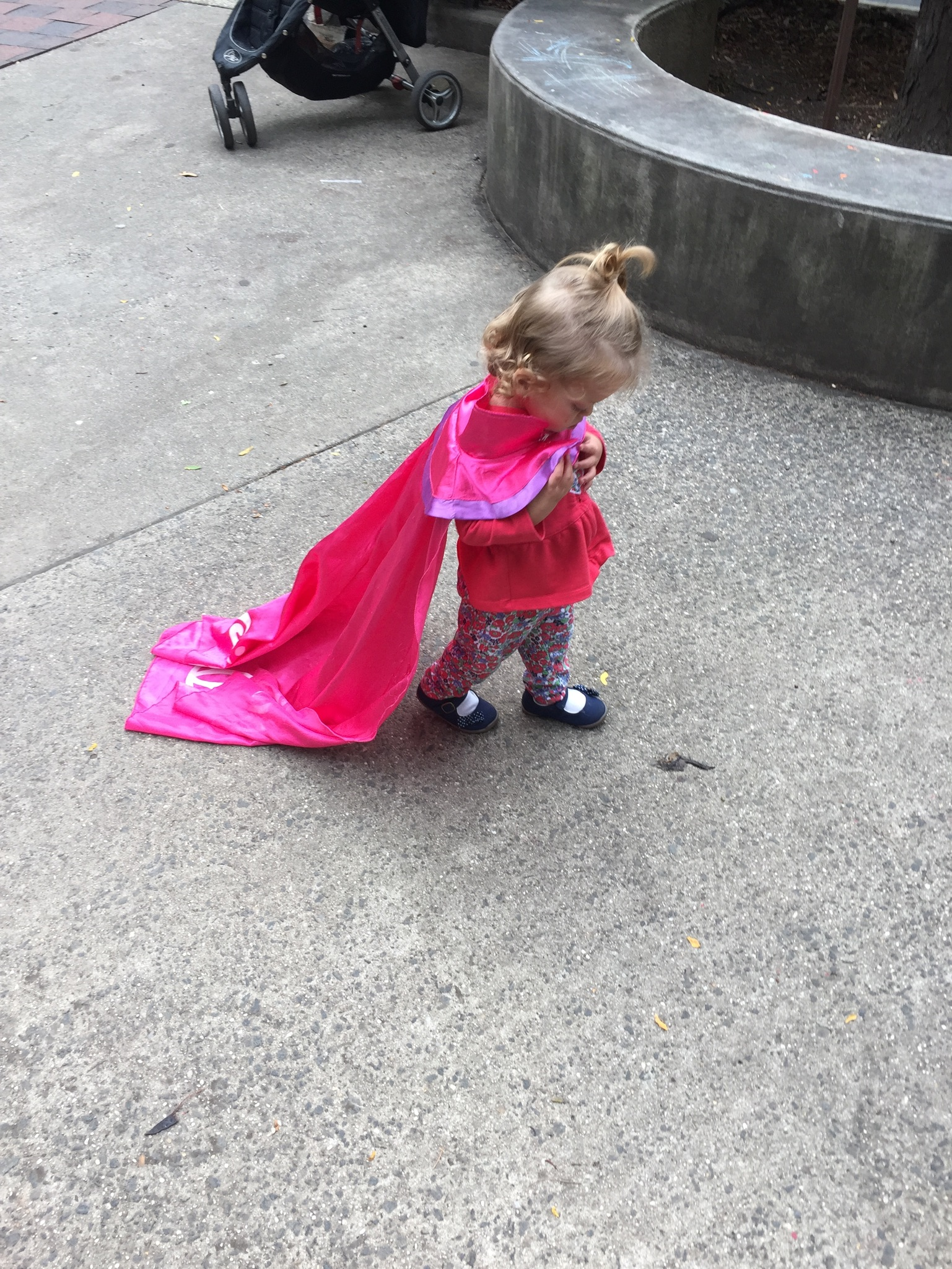 Lucie playing at our neighborhood playground. She made a friend who gave her an Anna cape from Frozen to play with for a bit.