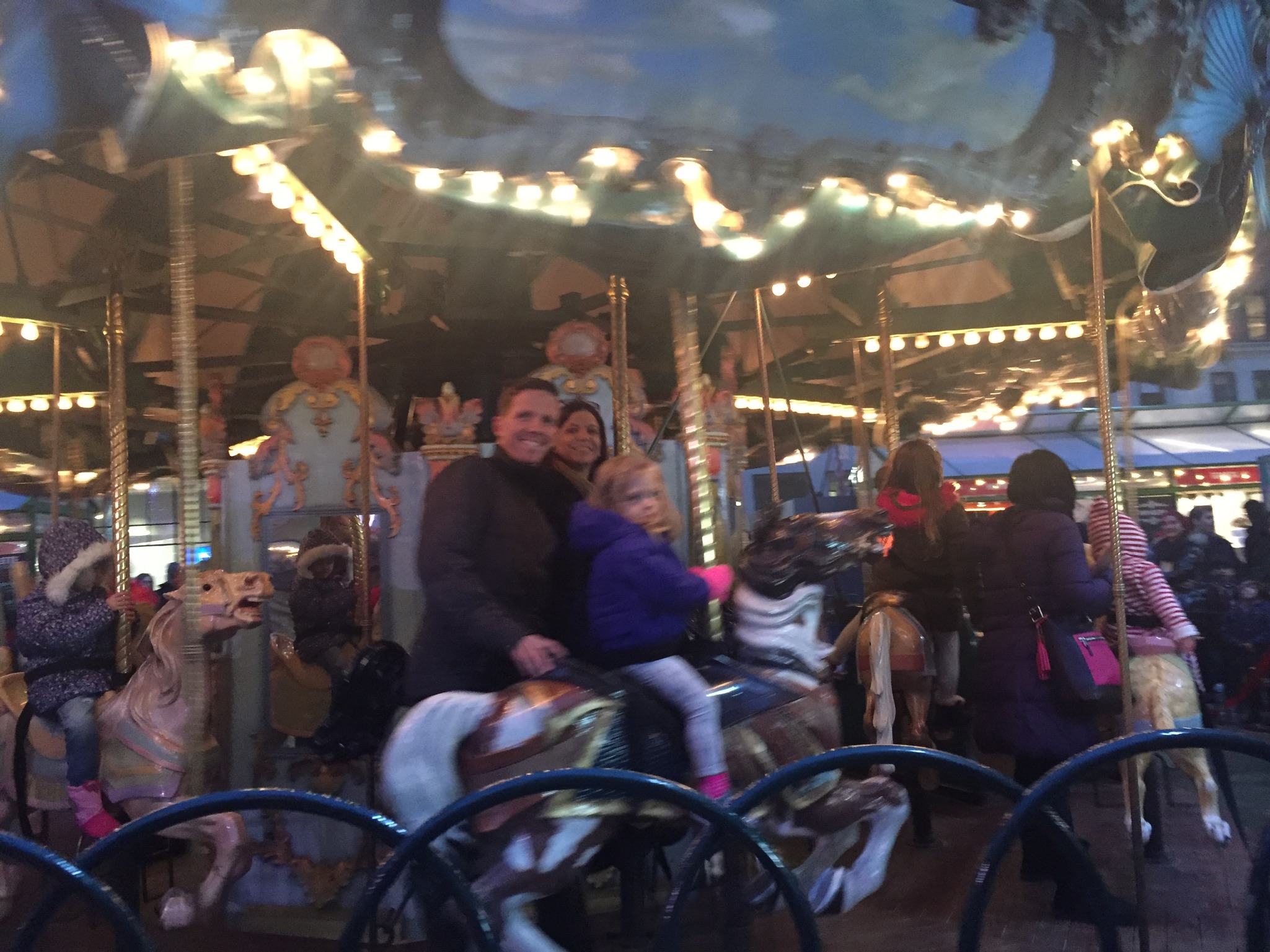 Abuela, Rob and Lucie on the carousel in Bryant Park.