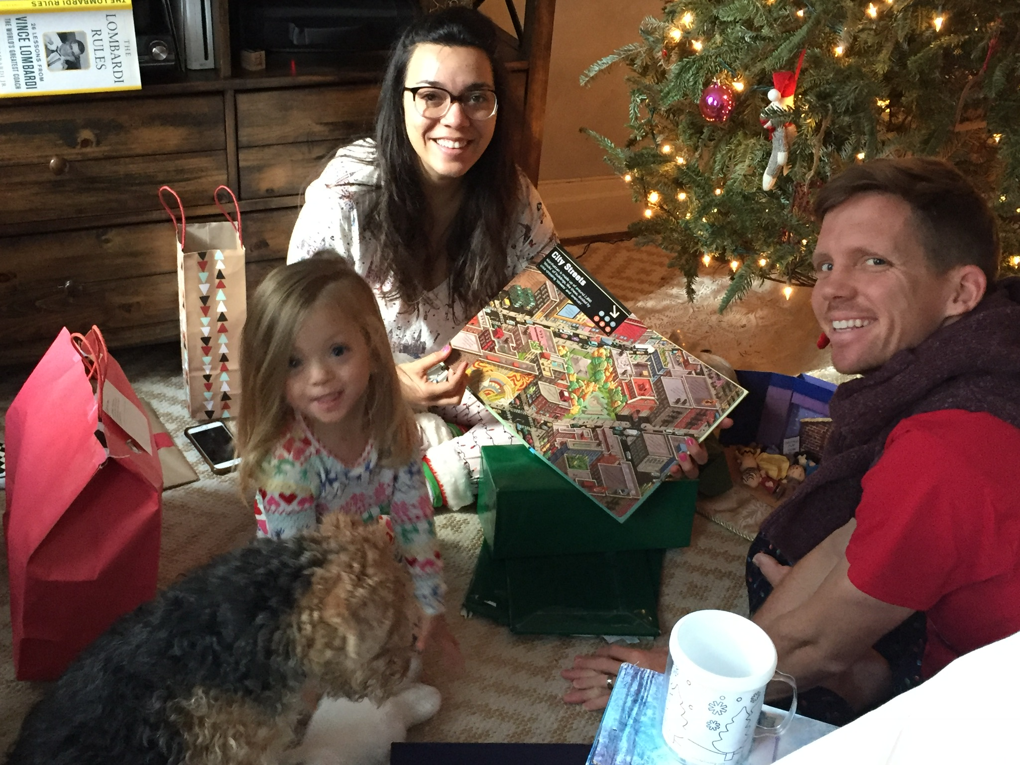 Opening gifts on Christmas morning.