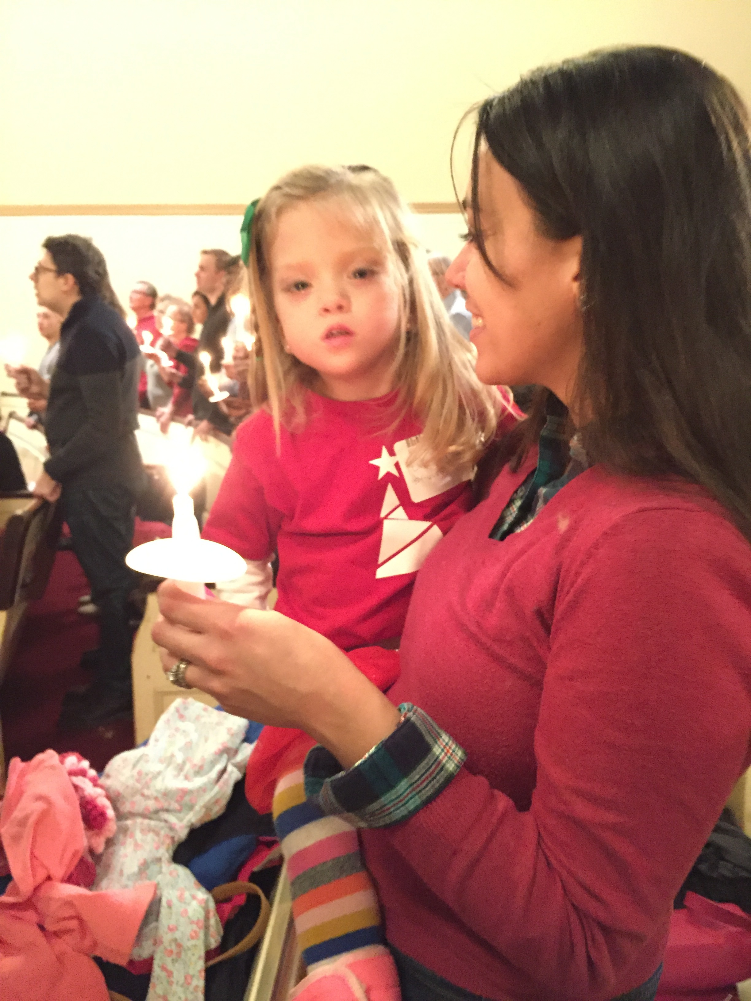 Christmas Eve service at church, singing  Silent Night .
