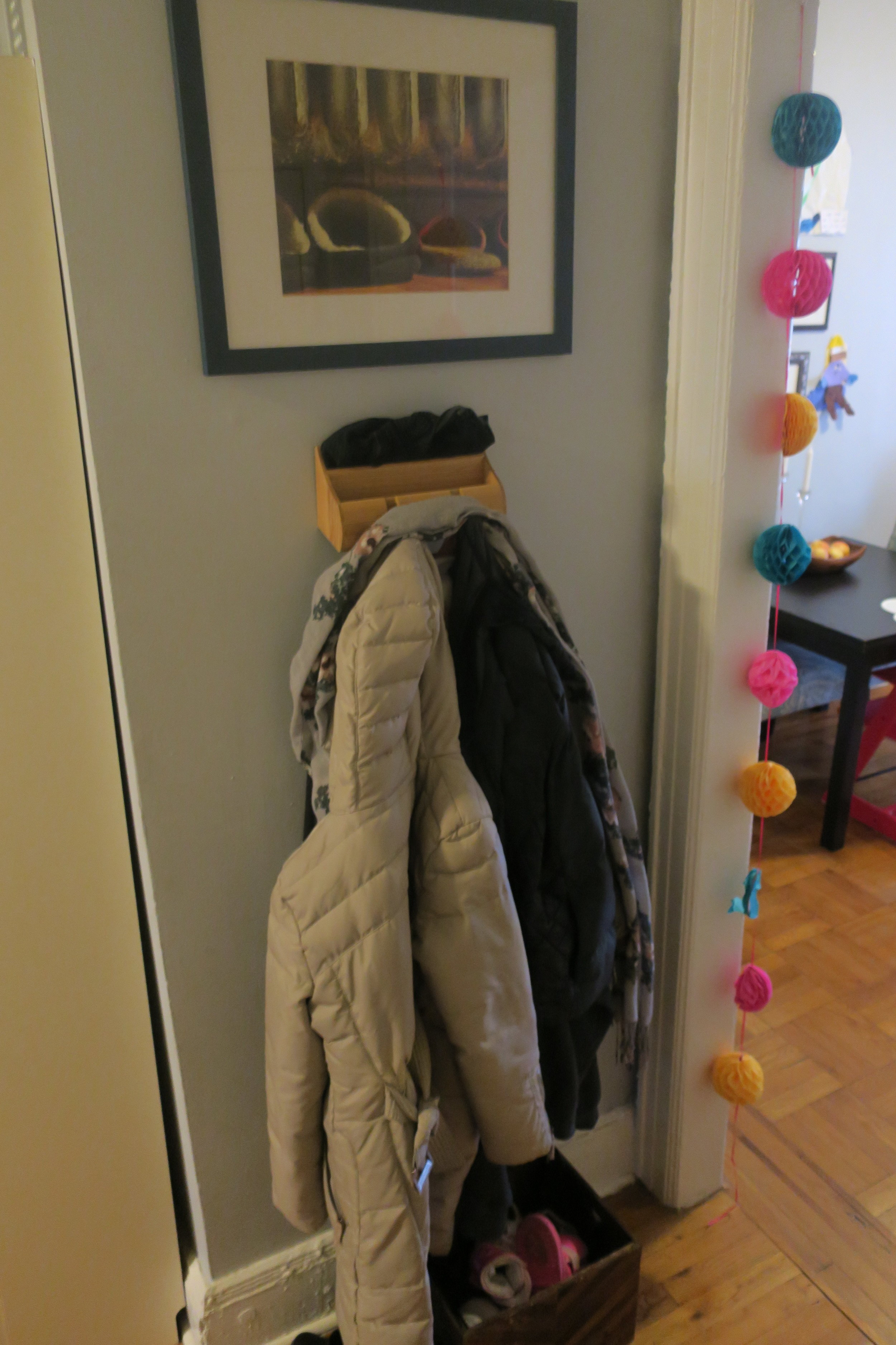 That photograph above the coat rack is one that Robby took in our first apartment in NYC. We would set our slippers under the radiator during the winter months and they'd be so toasty. We titled the photo  Home , and it's such a nice thing to see first thing when you walk in.