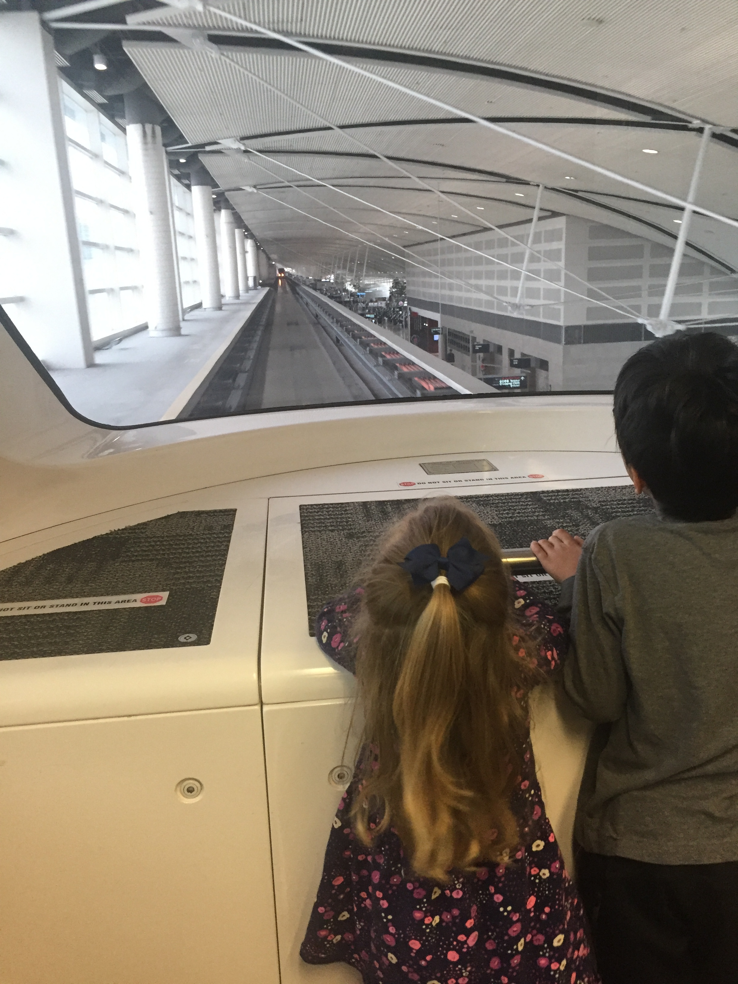 We had the BEST detour through the Detroit airport on our way to see the Paynes in Nashville. Lucie loved the red shuttle train.