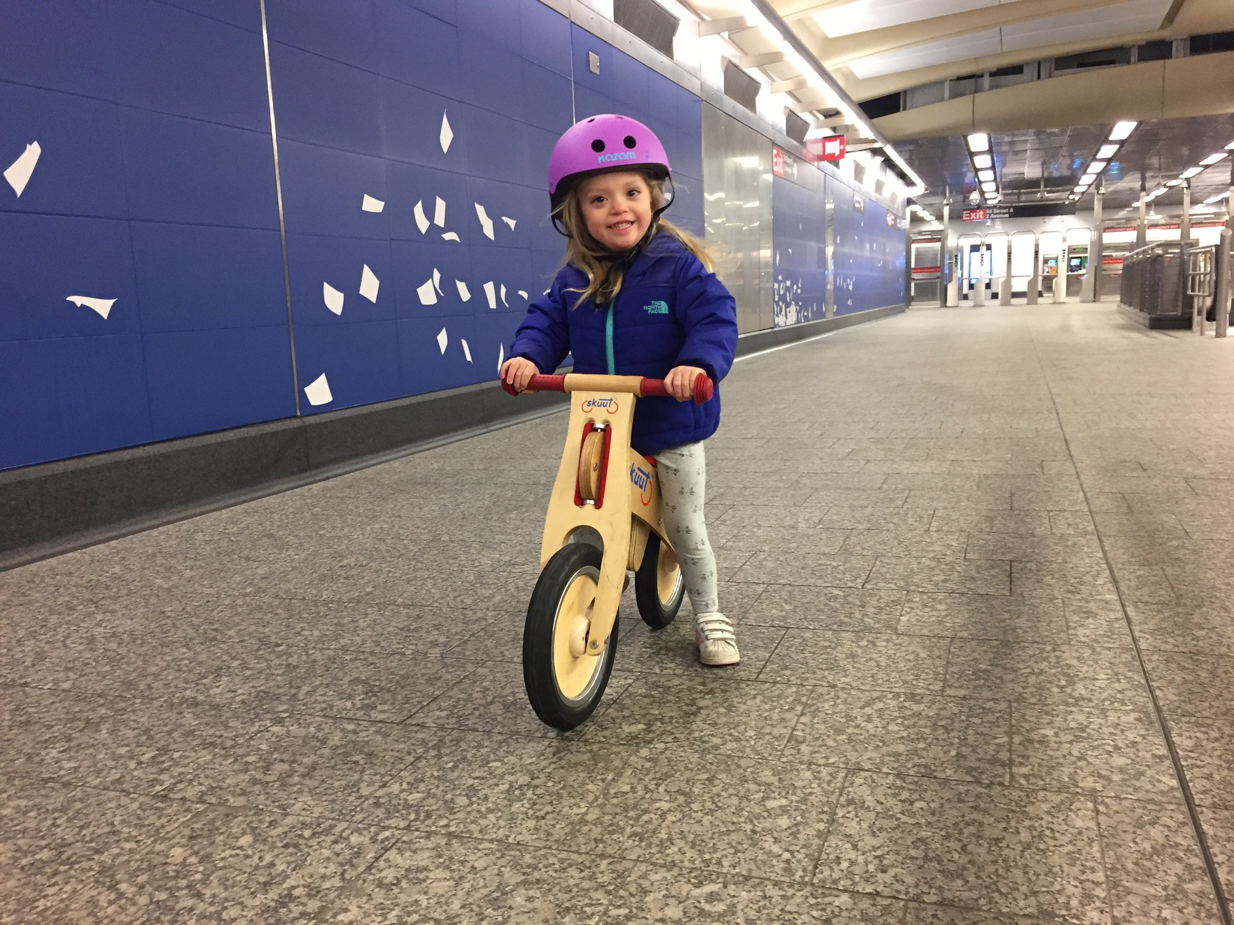 During the winter, we would take advantage of all of this space on the Mezzanine of the Q line by our apartment. Lucie would ride her scooter a ton and started to learn to ride a balance bike.