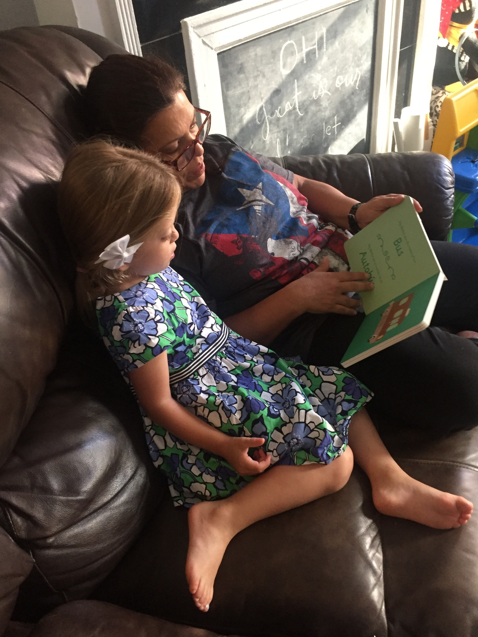 And yet another fave. Abuela reading the Selena book from Titi Eli to Lucie.