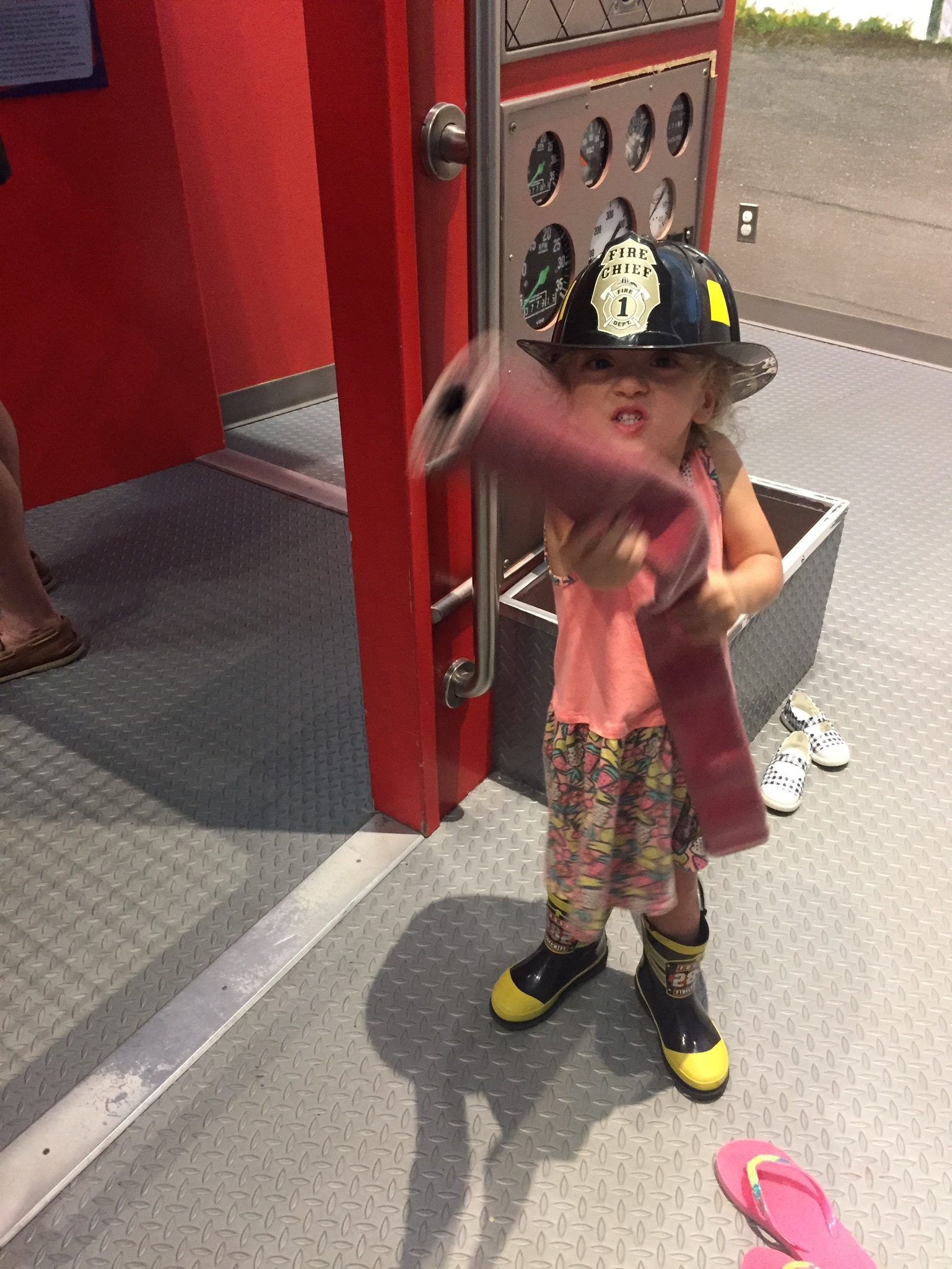 Our third day, we went to a Children's Musuem, which had a few fun areas to play, and interact. Of course, Lucie loved the firefighter station... and the...