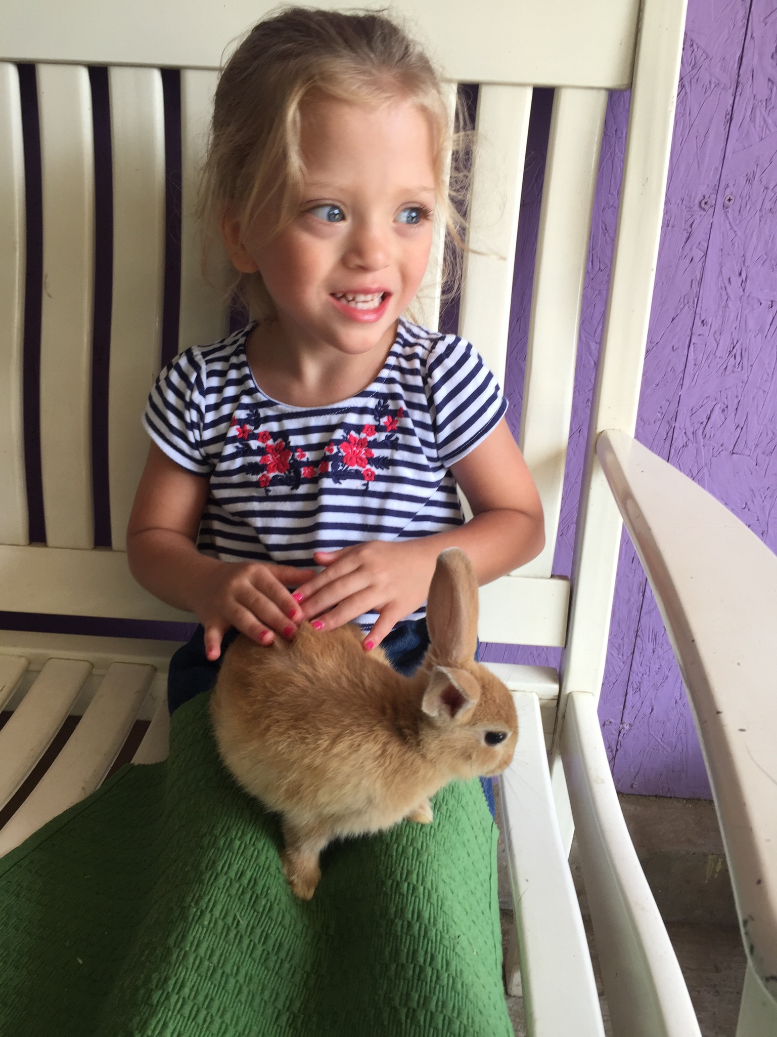 Lucie loooooved getting to hold the baby bunny.