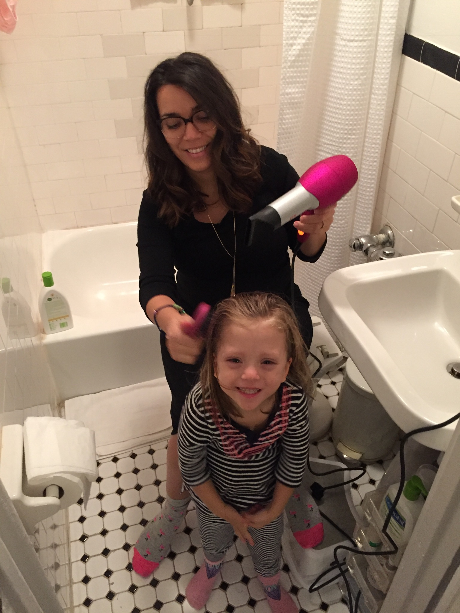 Now that it's getting colder, sometimes Lucie asks us to blow dry her hair after her bath so her hair will dry faster and so she can warm up. It's one of her favorite things to do.